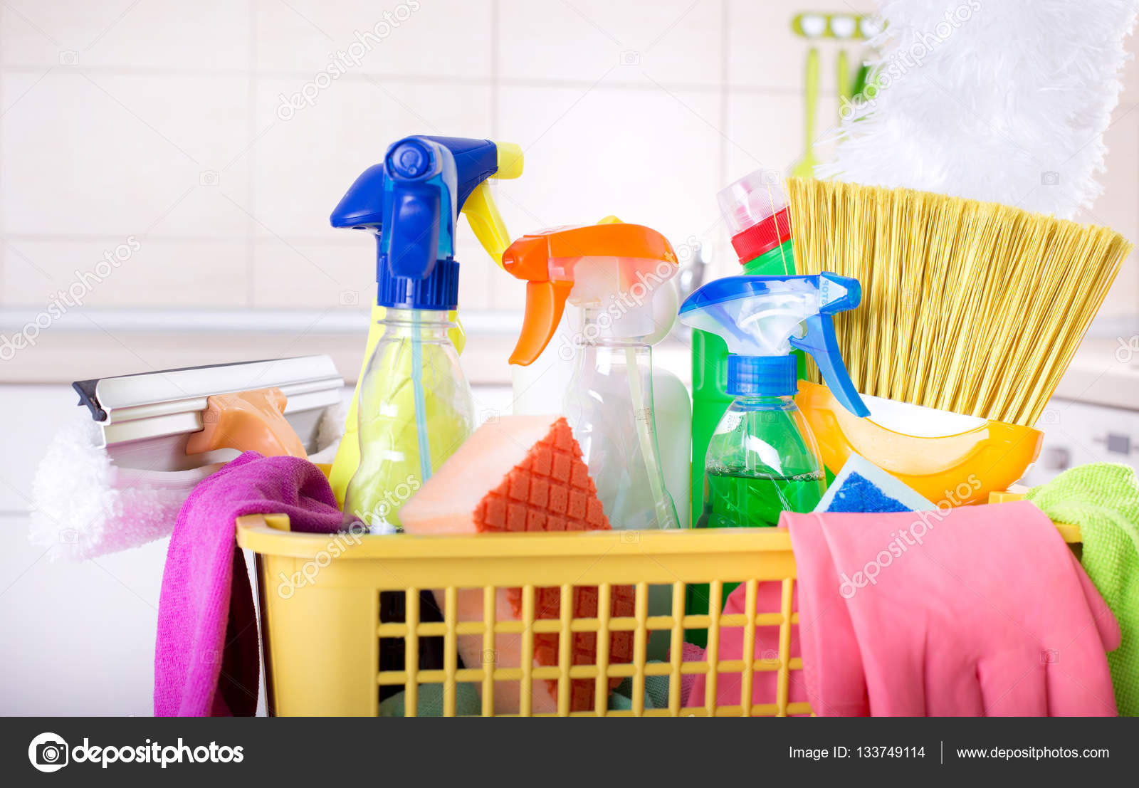 Cleaning supplies in basket in kitchen — Stock Photo ...