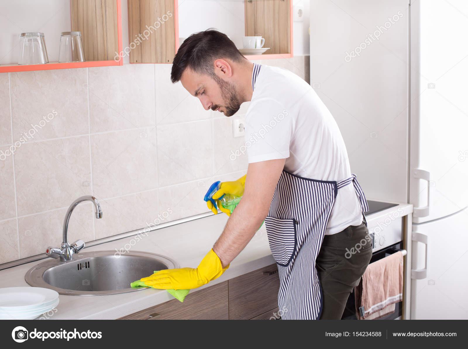Man cleaning kitchen countertop — Stock Photo © budabar #154234588
