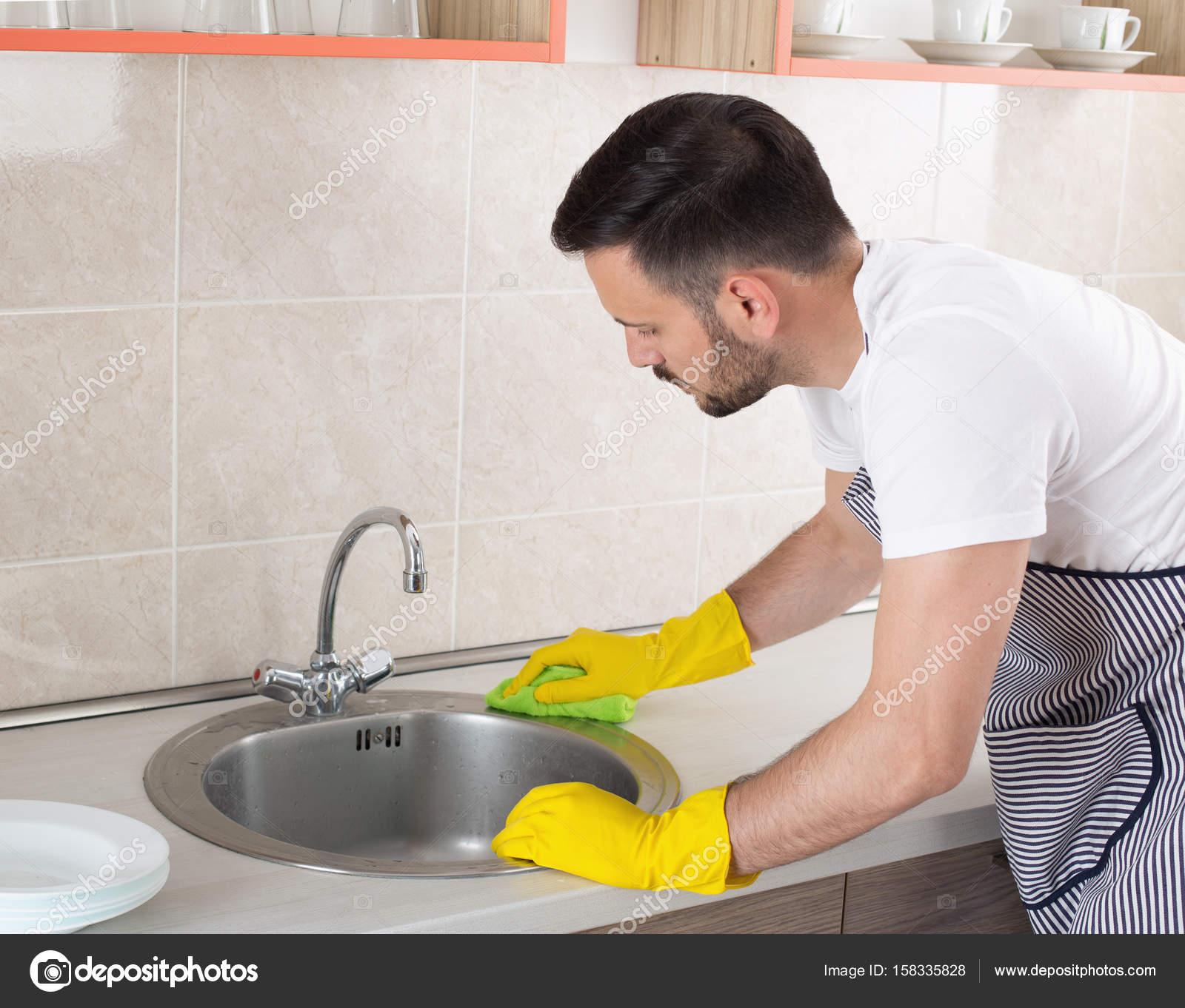 Man cleaning kitchen sink — Stock Photo © budabar #158335828