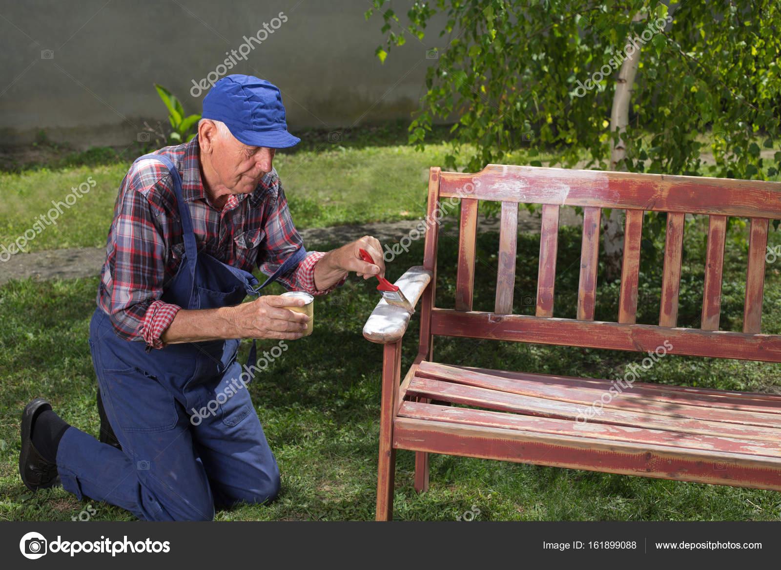 Peachy Old Man Painting Bench In Garden Stock Photo C Budabar Machost Co Dining Chair Design Ideas Machostcouk