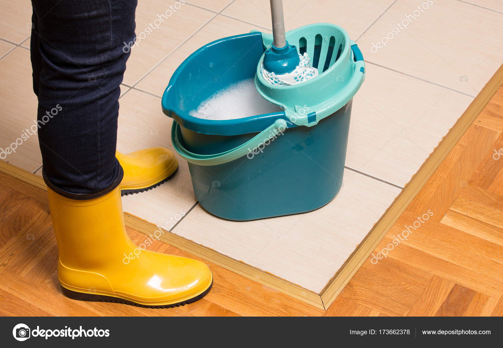 Housekeeper mopping tiled floor stock photo budabar 173662378 housekeeper mopping tiled floor stock photo dailygadgetfo Image collections