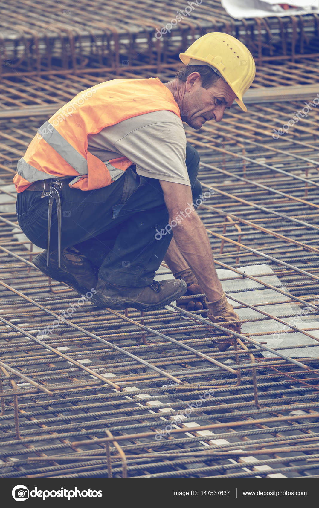 Ironworker posing at construction site – Stock Editorial Photo