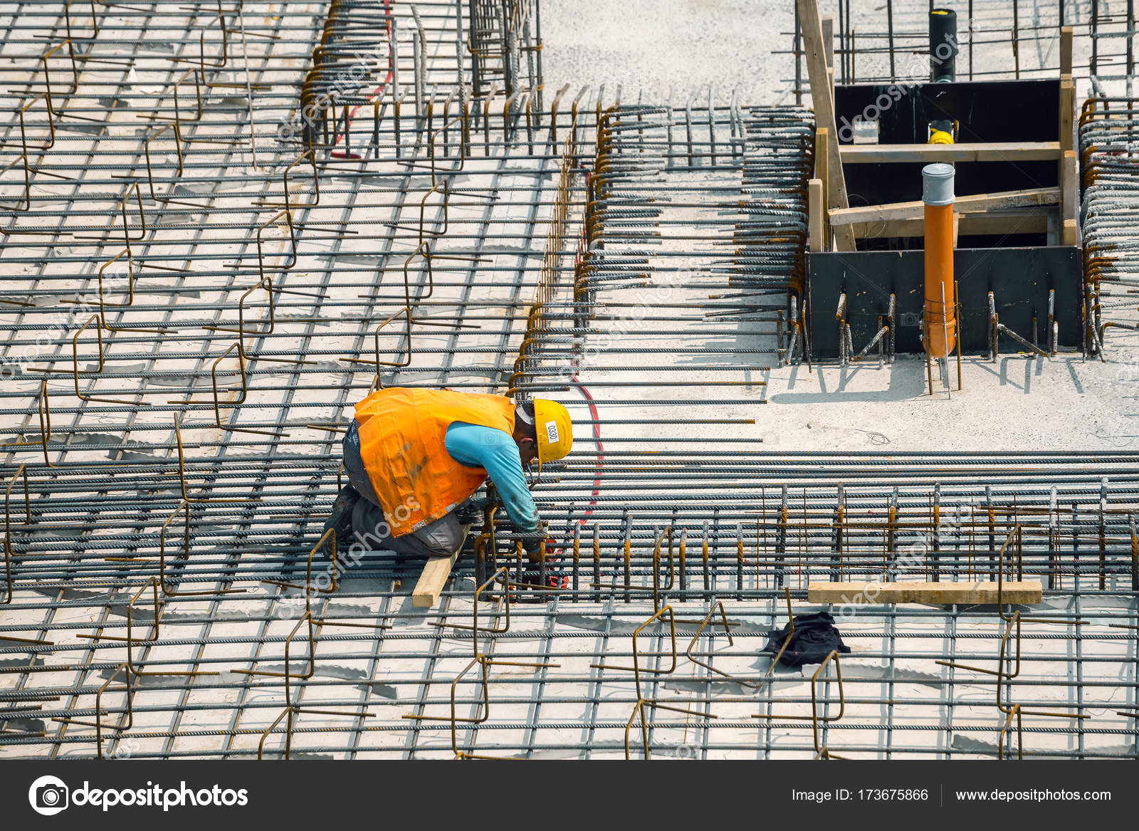 belgrade serbia august 22 2017 construction worker install rebar for new building rebar worker with reinforcing rebar photo by kataklinger