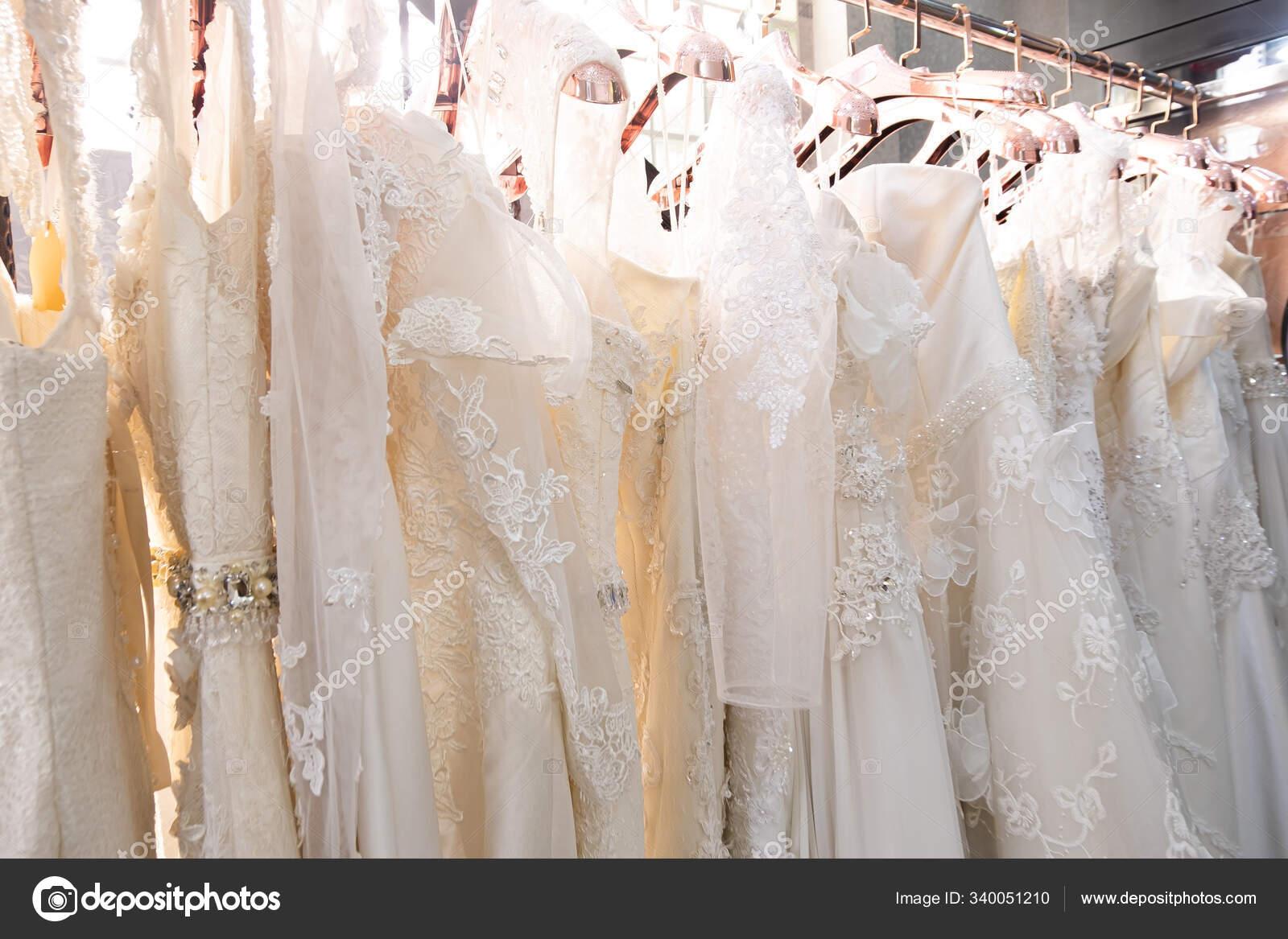 Beautiful White Bridal Dress Texture Background Wedding Dresses Hanging Hanger Stock Photo C Setthaphatdc415 Gmail Com 340051210