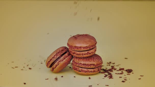 French chocolate macaroons with falling grated chocolate. Sweet dessert.