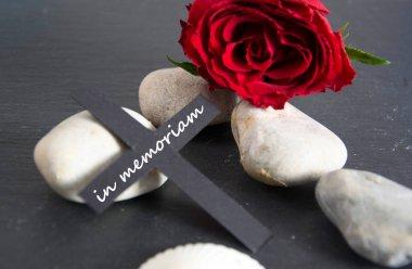 in memoriam  written on a black cross