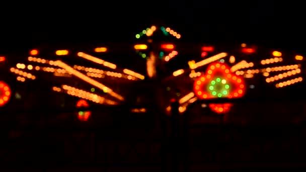 Blurred Amusement park ride at night.