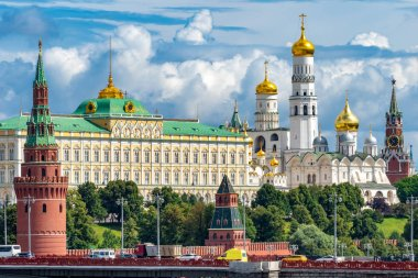 Moscow. Russia. Grand Kremlin Palace on a summer day. Moscow on the background of blue sky. Kremlin towers. Panorama of the Kremlin embankment. Spasskaya Tower. Temples of Russia. Moscow sights.