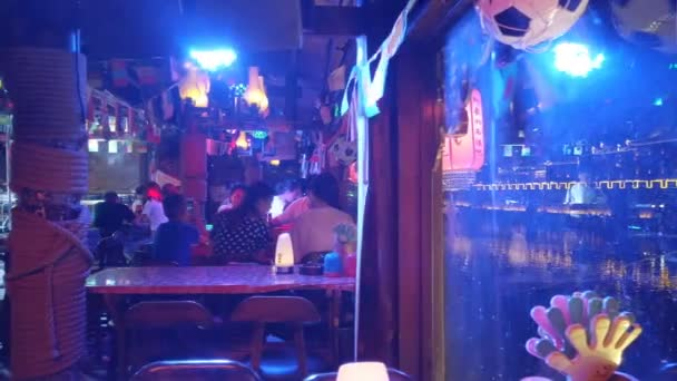 Fenghuang, Hunan, China, JULY 29, 2019. View of inside the bar in Fenghuang Ancient Town at night.