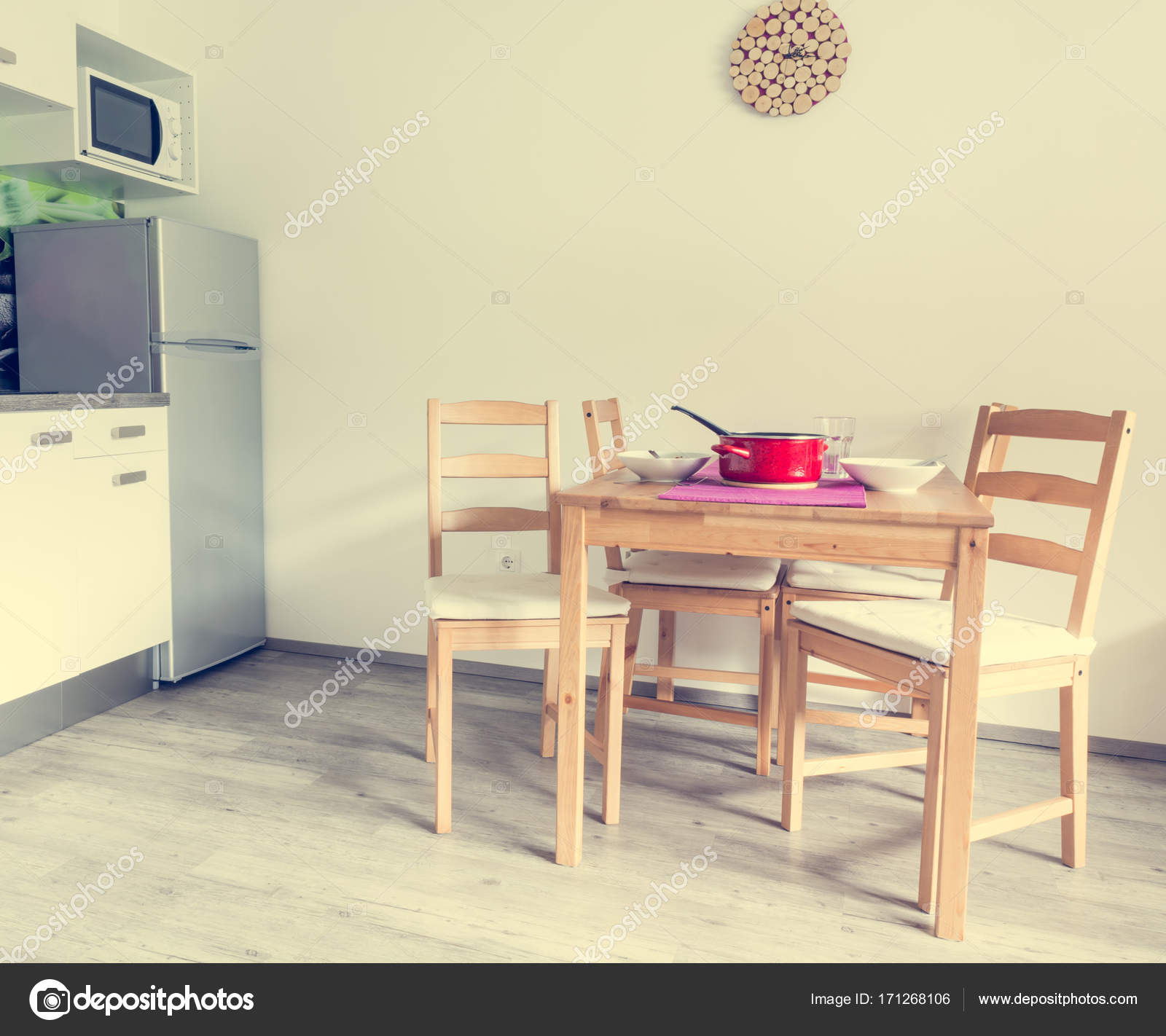 Modern and minimalistic kitchen set wooden table and chairs
