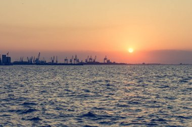 Spectacular panorama view of sun setting into Thermaic gulf.