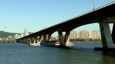 Boat floating under Wonhyo Grand Bridge