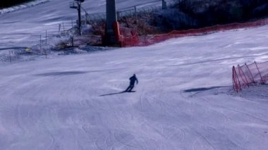 Sportsman skiing on slope