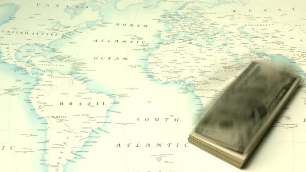 dollar banknotes flying over world map background, economy concept
