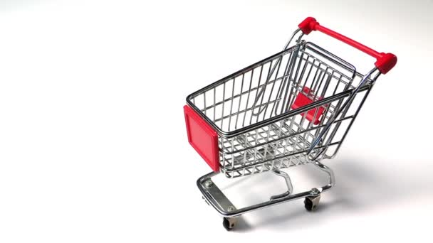 coins falling down in shopping cart, business concept