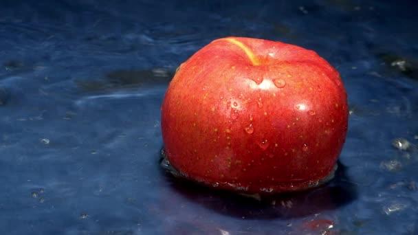 water flowing on ripe apple