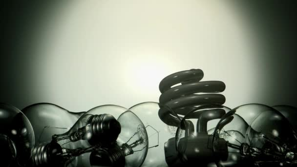 LED lamp turning on in pile of light bulbs, energy concept