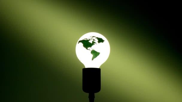 žárovka s světa mapa svítící temné místnosti, energetické koncepce