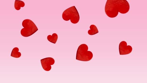 Valentine koncept s červeným padající srdce na růžovém pozadí
