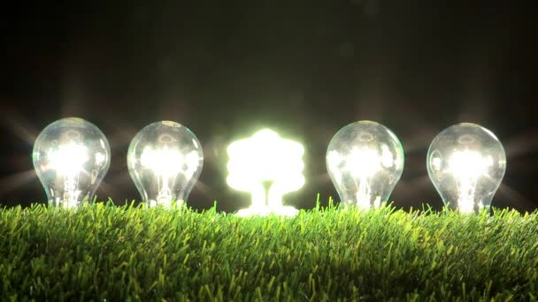 led lamp illuminating while light bulbs turning off in grass , energy concept
