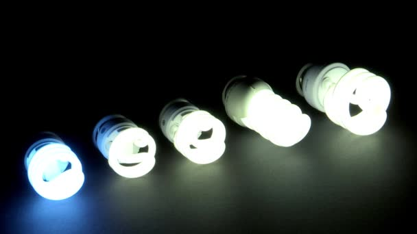 light bulbs flashing and turning off in dark room, energy concept