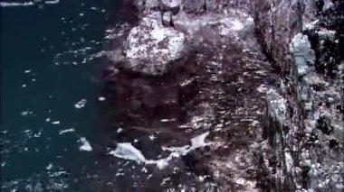Ocean waves crashing on coastal cliffs