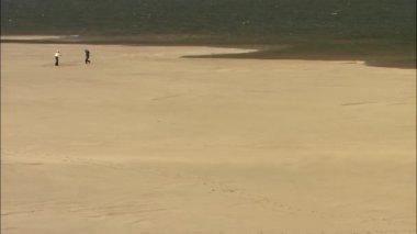 Couple on sandy shore of Seomjingang River