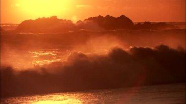Ocean waves crashing on sandy beach