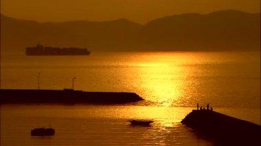 orange sunset reflecting on sea surface
