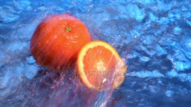 water flowing on ripe oranges