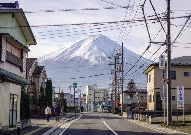Yamanashi, Japan - Dec 4, 2016. People walking on street with Fujisan background in Yamanashi, Japan. Mount Fuji located on Honshu Island, is the highest mountain in Japan.