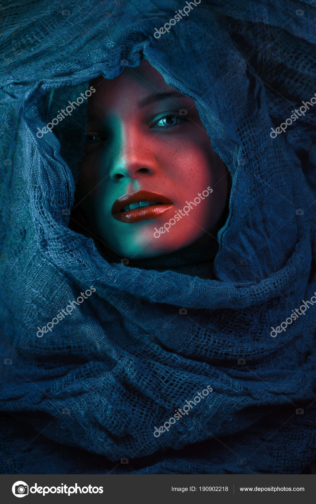 Woman covers her face with a blue cloth b31c04554