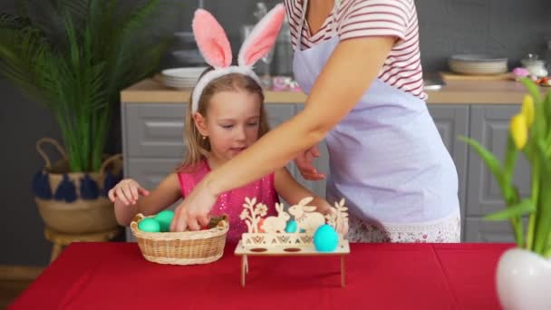 Little Girl with Mother Decorating Easter Table