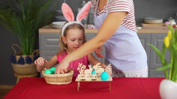 Woman and Little Girl Decorating Easter Table