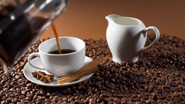 Closeup of Pouring Black Arabica Coffee in a Cup