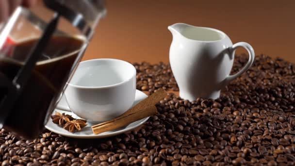 Closeup of Pouring Black Coffee in a White Cup