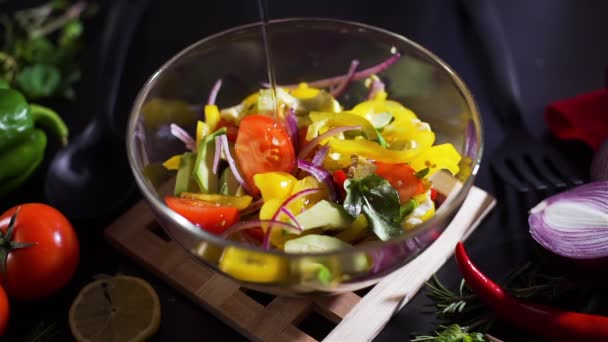 Pouring Olive Oil in a Bowl with Vegetable Salad