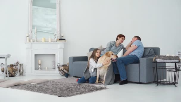Parents with Daughter and Dog Resting at Home