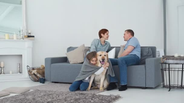 Parents with Daughter and Pet in the Living Room