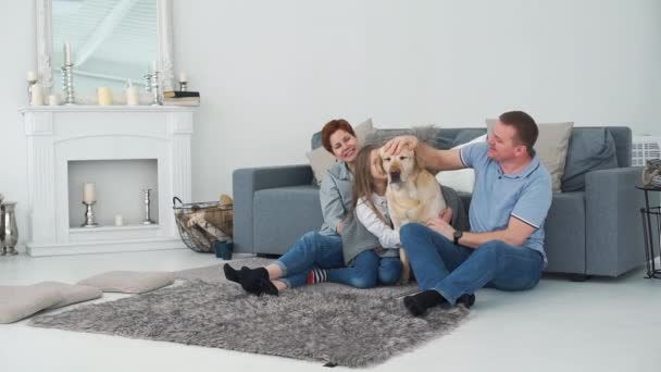 Parents with Daughter and Dog Relaxing near Sofa
