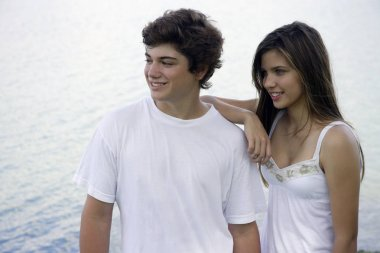 Teen couple by lake