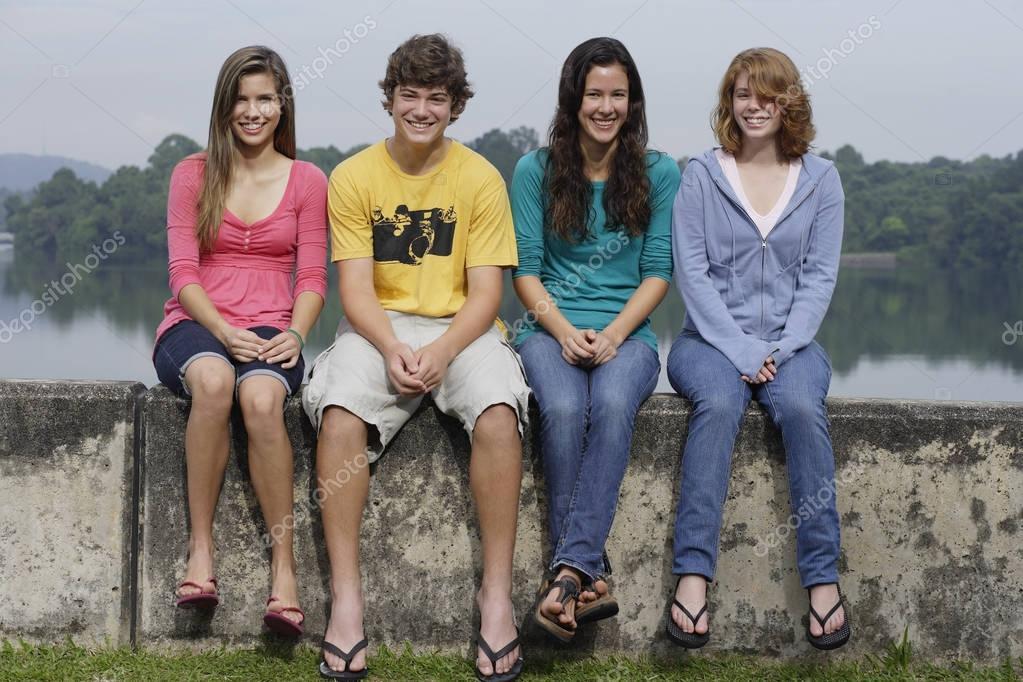 Group of teens next to lake
