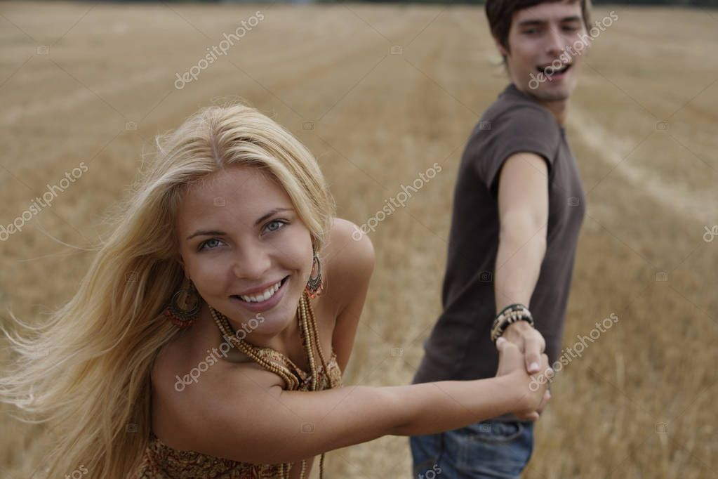 Young couple playfully holding hands