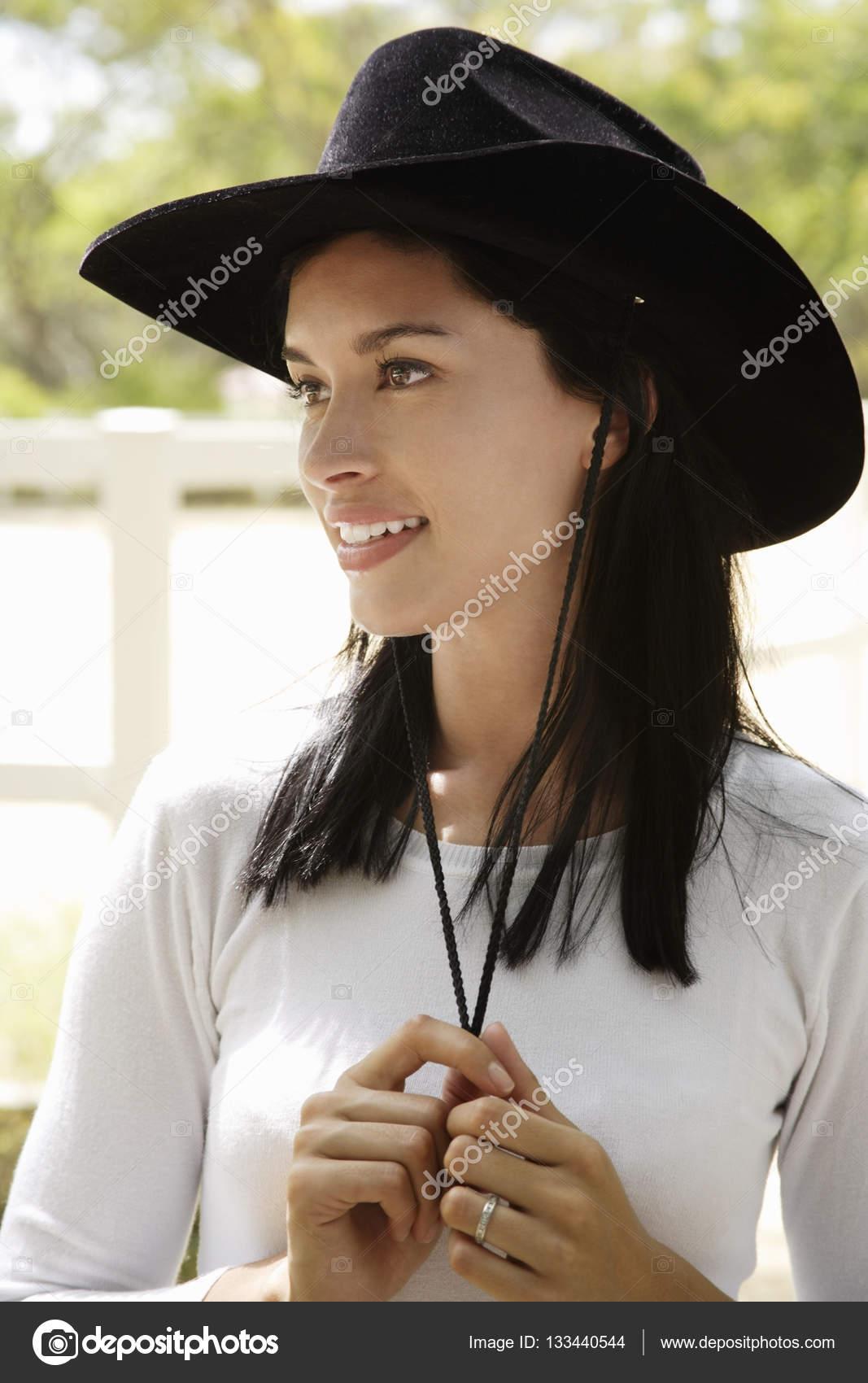 woman wearing black cowboy hat — Stock Photo © MicrostockAsia  133440544 f29ef74d7f2e