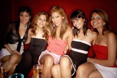 Women sitting side by side
