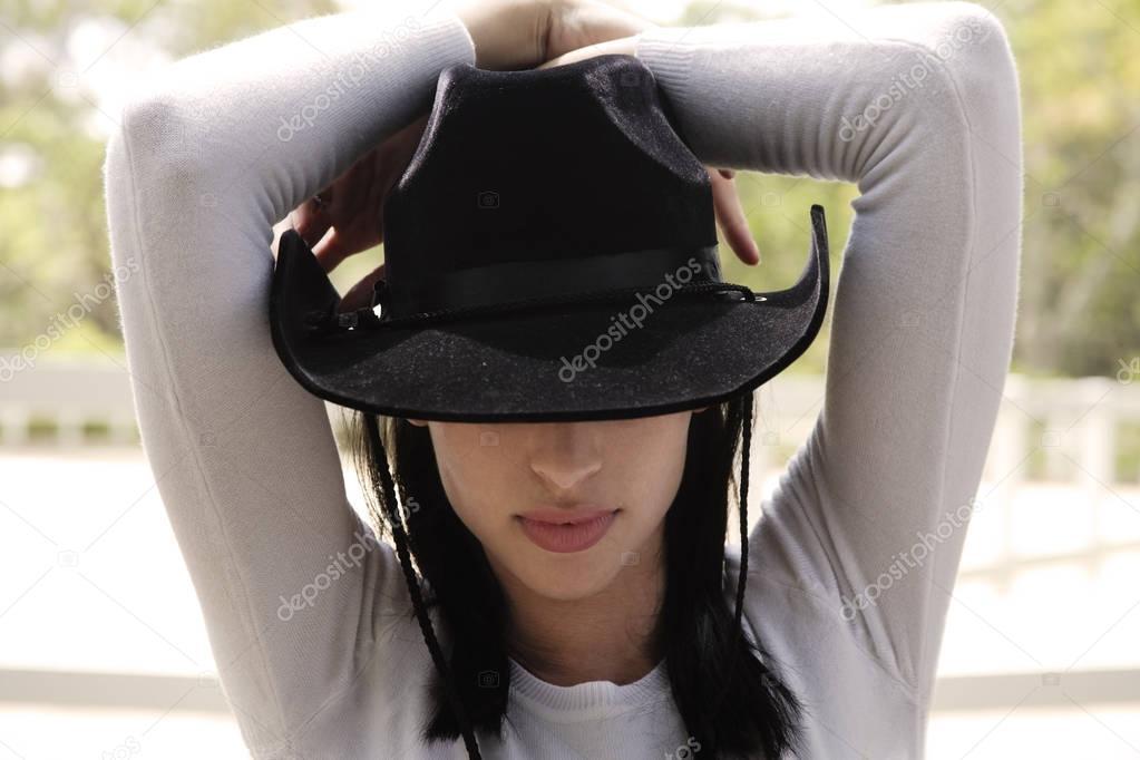 woman wearing black cowboy hat