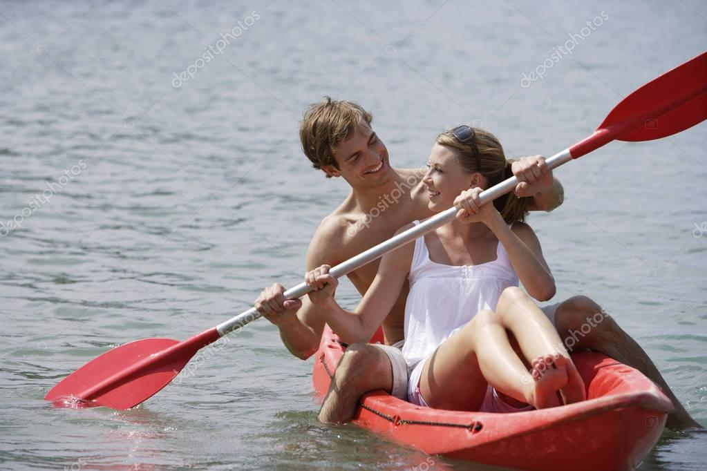 Couple kayaking together