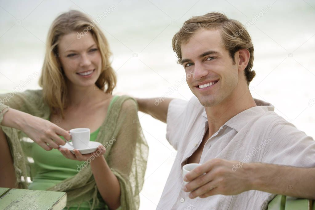 couple having coffee at beach cafe