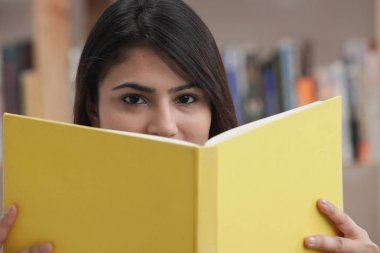 female college student in library