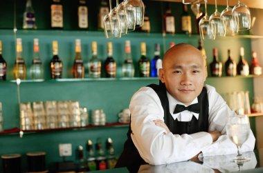 Bartender behind bar counte